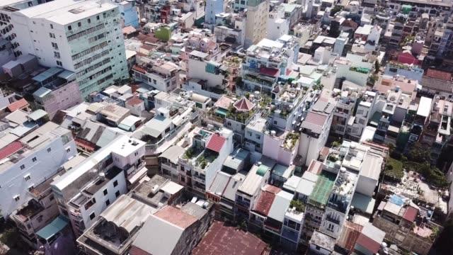 drone flight above dense housing in saigon, ho chi minh city, vietnam - vietnam meridionale video stock e b–roll