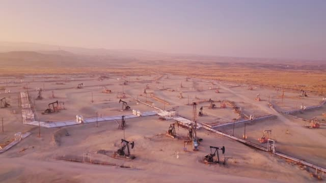 Drone Flight Across California Oil Field at Sunset