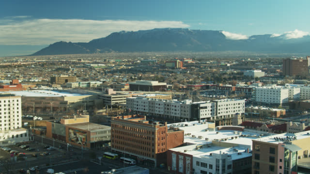 drone flight across downtown albuquerque early in the morning - albuquerque new mexico stock videos & royalty-free footage