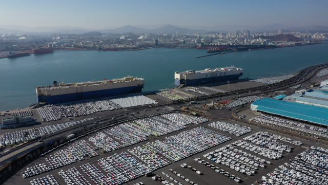 drone flight across hyundai motors exporting port in yeompo-dong, ulsan city south korea - automobilindustrie stock-videos und b-roll-filmmaterial