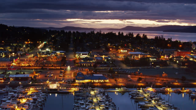 drone flight across marina of streets of anacortes, wa at night - anacortes stock videos & royalty-free footage