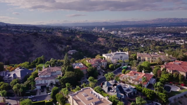 drone flight across wealthy neighborhood - wealth stock videos & royalty-free footage
