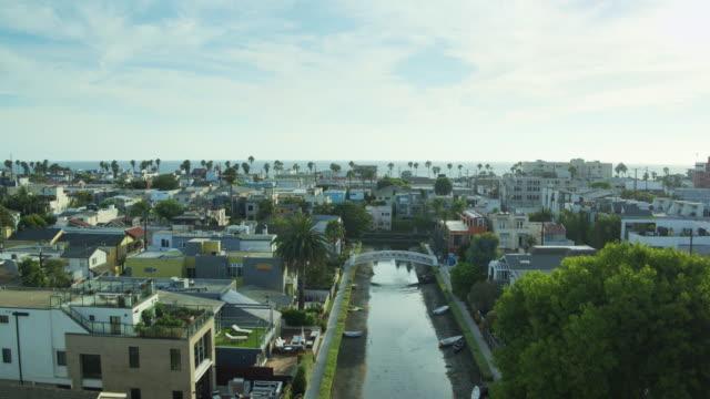 Drone Flight Along Canal in Los Angeles Towards Venice Beach