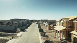 Drone Flight Along New Street with Half Built Houses
