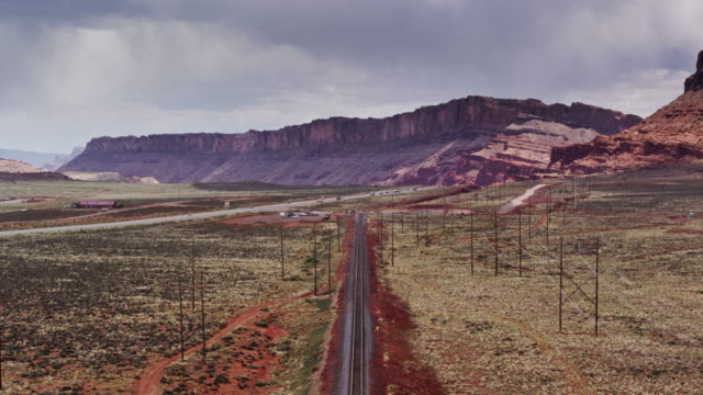 drone flight along railroad tracks near moab, ut - rail transportation stock videos & royalty-free footage