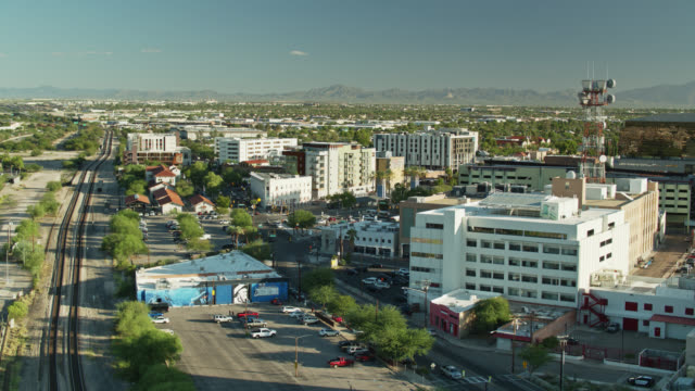 drone flight along train tracks on the edge of downtown tucson - arizona stock videos & royalty-free footage