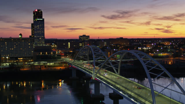 drone flight alongside broadway bridge over arkansas river towards downtown little rock - arkansas stock videos & royalty-free footage