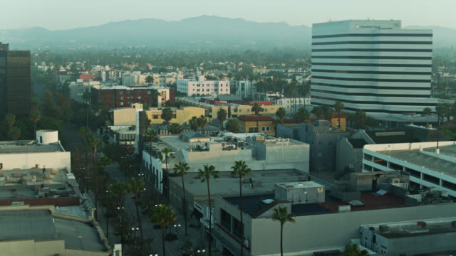 drone flight alongside empty third street promenade on foggy morning during covid-19 lockdown - aerial - epidemic stock videos & royalty-free footage