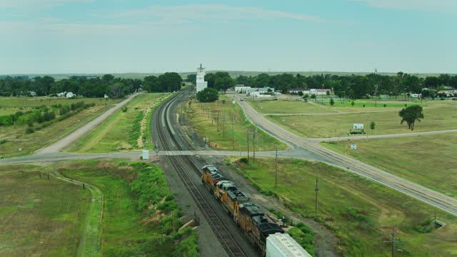 drone flight alongside locomotive of freight train in nebraska - freight elevator stock videos & royalty-free footage