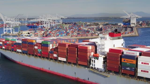 drone flight alongside ship arriving in port - long beach california stock videos & royalty-free footage