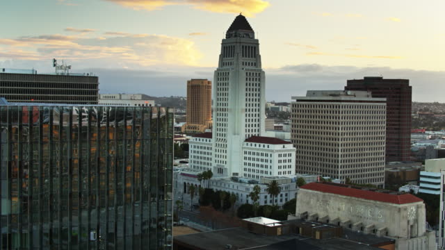 drone flight approaching los angeles city hall - town hall government building stock videos & royalty-free footage