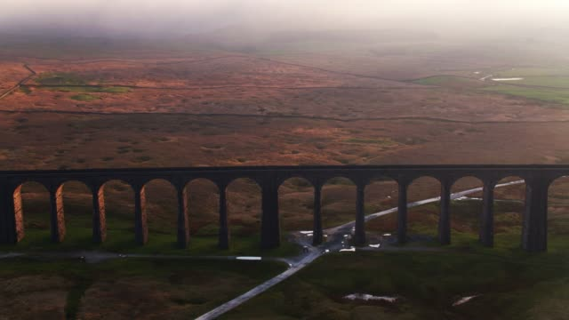 drone flight approaching ribblehead viaduct at sunset - victorian stock videos & royalty-free footage