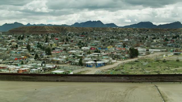 drone flight approaching us/mexico border wall and puerto de anapra, ciudad juárez - surrounding wall stock videos & royalty-free footage