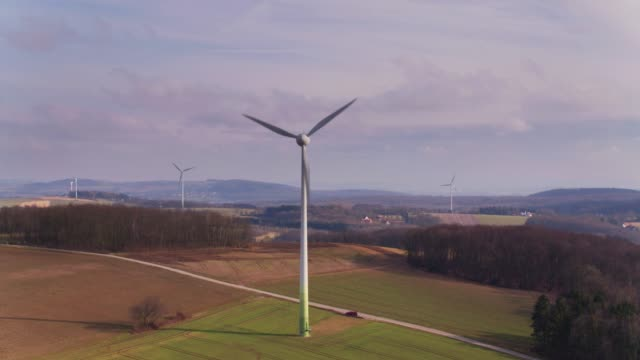 Drone Flight Approaching Wind Turbines in German Countryside