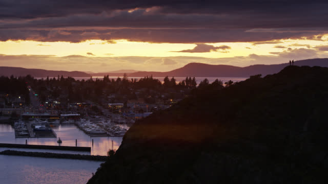 drone flight around cap sante looking towards anacortes - anacortes stock videos & royalty-free footage