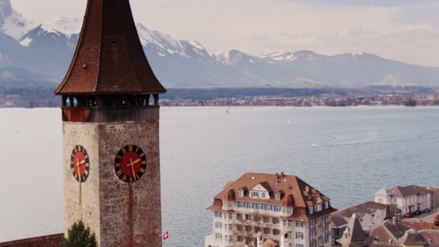 vídeos de stock e filmes b-roll de drone flight around clock tower in oberhofen, switzerland - spire