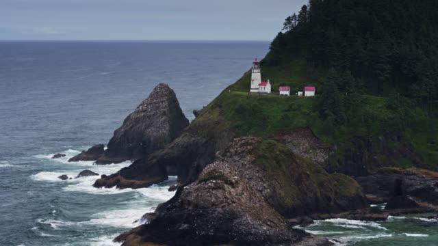 drone flight around heceta head lighthouse - heceta head stock videos & royalty-free footage