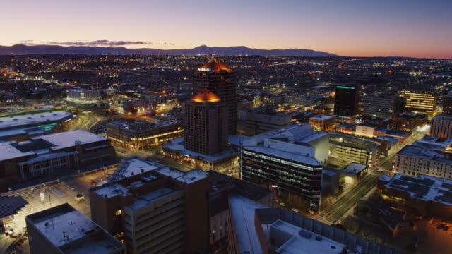 drone flight around iconic albuquerque plaza and and hyatt - albuquerque new mexico stock videos & royalty-free footage