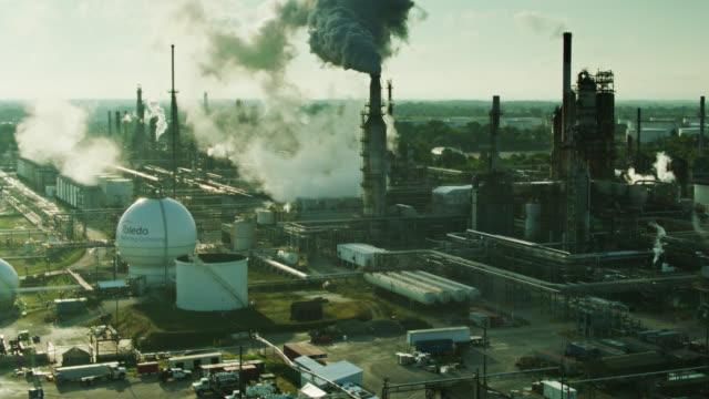 drone flight around oil refinery in toledo, ohio - plant stock videos & royalty-free footage