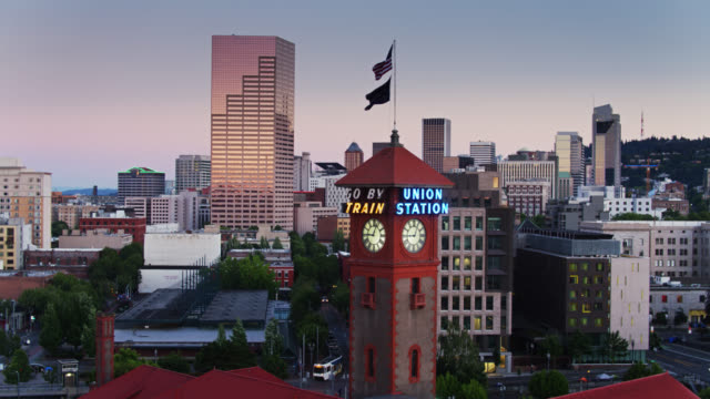drone flight around portland union station clock tower - portland oregon sunset stock videos & royalty-free footage