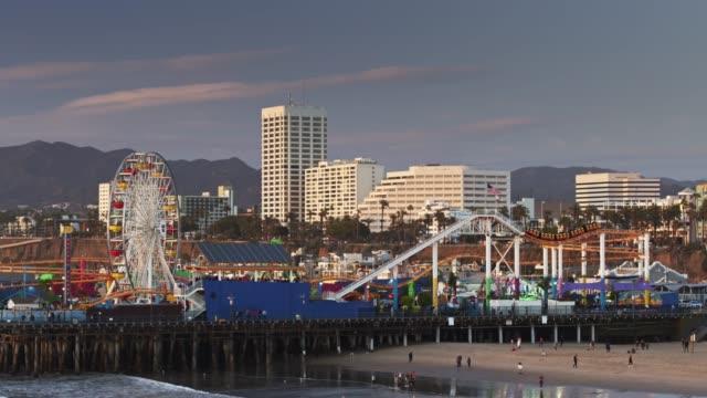 drone flight around santa monica pier - establishing shot stock videos & royalty-free footage