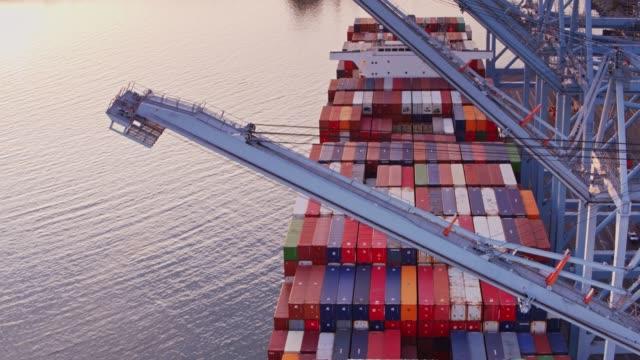 Drone Flight Around Ship to Shore Gantry Cranes Over Container Ship