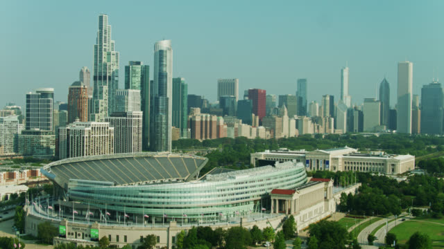 drone flight around soldier field with field museum and chicago loop - chicago illinois stock videos & royalty-free footage