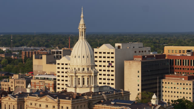 drone flight around state capitol building dome in lansing, michigan - lansing stock videos & royalty-free footage