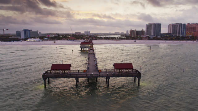 drone flight around tip of pier 60 fishing pier in clearwater, florida - gulf of mexico stock videos & royalty-free footage