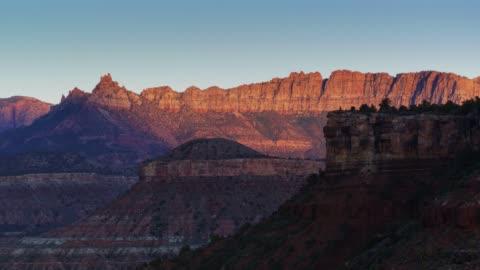 drone flight around utah rock mesas - canyon stock videos & royalty-free footage