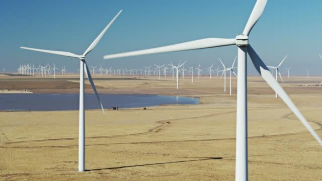 drone flight around wind turbines in texas wind farm - propeller stock videos & royalty-free footage