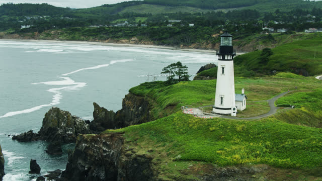 drone flight around yaquina head lighthouse - oregon coast stock videos & royalty-free footage