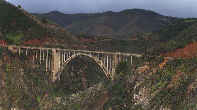 drone flight away from bixby creek bridge - bixby creek bridge stock videos & royalty-free footage