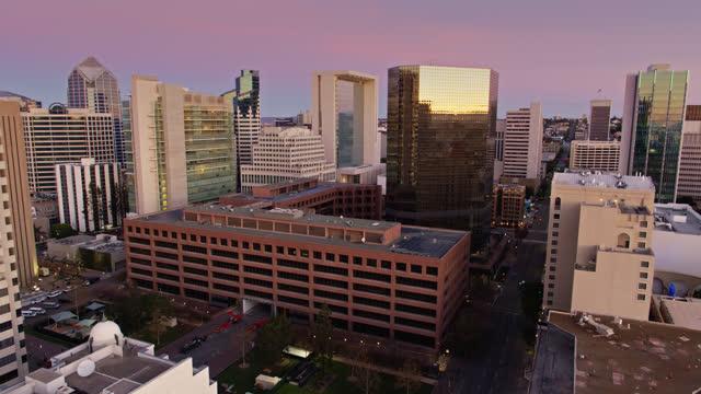 drone flight between downtown san diego buildings before sunrise - san diego stock videos & royalty-free footage