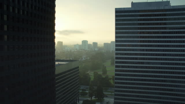 drone flight between office towers in century city, los angeles - century city stock videos & royalty-free footage