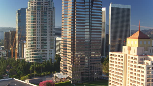 drone flight circling around century city, los angeles - century city stock videos & royalty-free footage