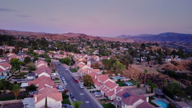 drone flight down suburban street - santa clarita video stock e b–roll