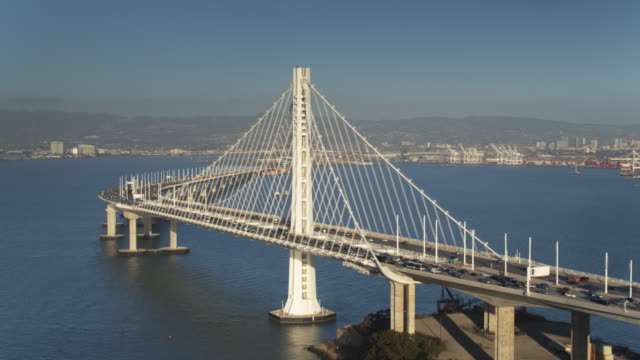 vídeos de stock e filmes b-roll de drone flight from yerba buena island towards the bay bridge and oakland, california - san francisco oakland bay bridge