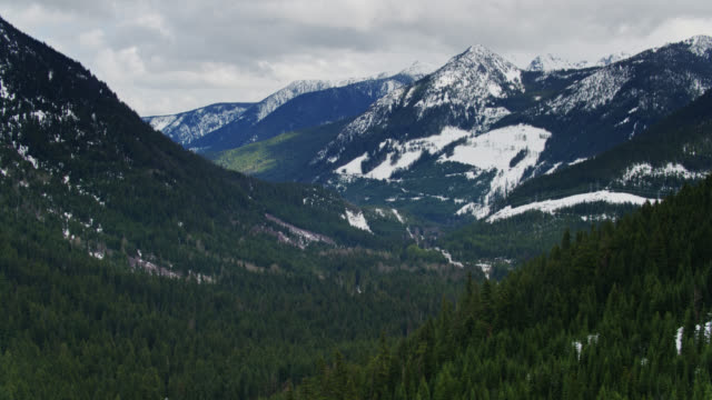 drone flight high over dramatic valley - stevens pass, wa - pacific crest trail stock videos & royalty-free footage