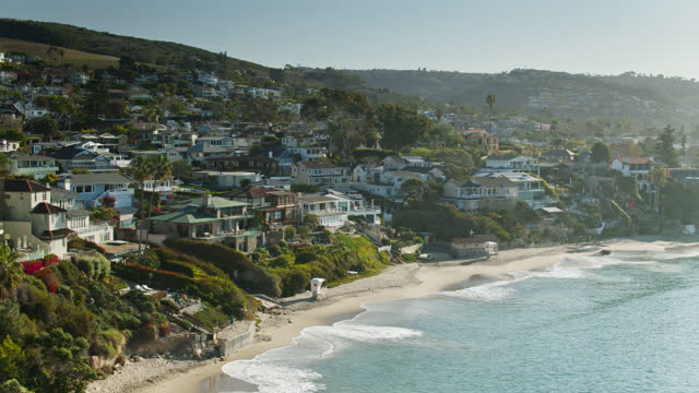 drone flight out over bluff to look at houses around crescent bay in laguna beach - laguna beach california stock videos & royalty-free footage