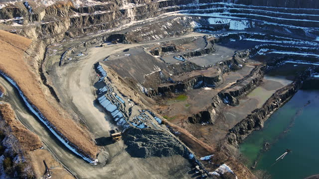 drone flight over a gravel quarry - construction machinery stock videos & royalty-free footage