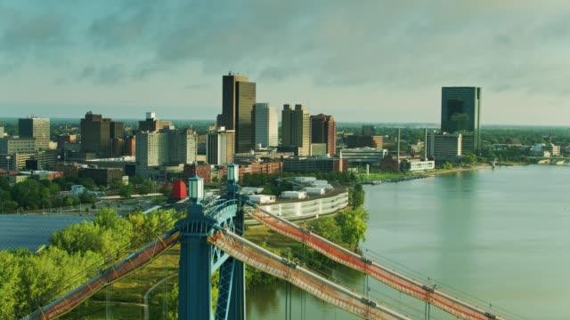 drone flight over anthony wayne bridge towards downtown toledo, ohio - ohio stock videos & royalty-free footage