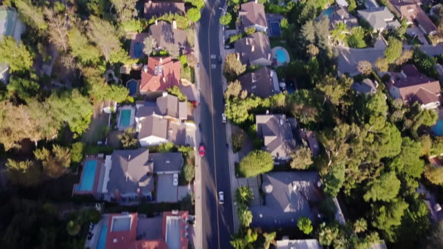 drone flight over beverly hills - urban road stock videos & royalty-free footage