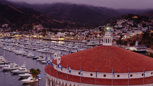 drone flight over catalina casino towards avalon at twilight - channel islands california stock videos & royalty-free footage