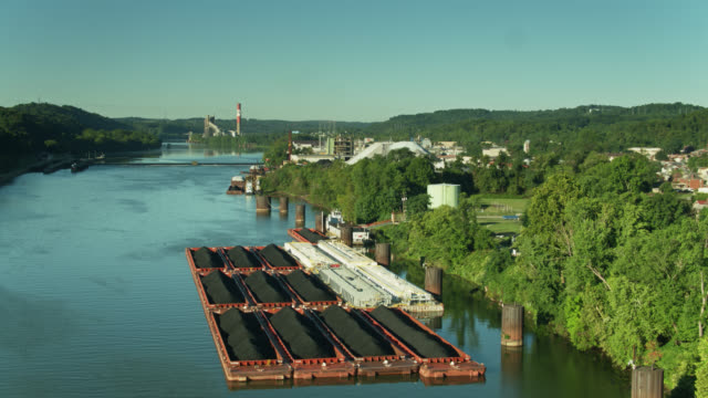 drone flight over coal barges on the monongahela river in west elizabeth, pennsylvania - barge stock videos & royalty-free footage