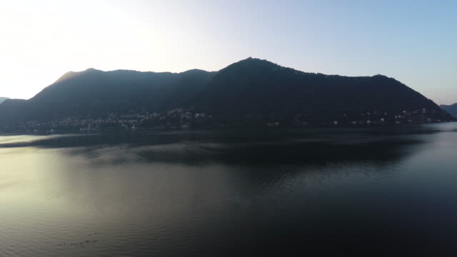 Drone flight over Como lake at sunrise with a wide angle lens