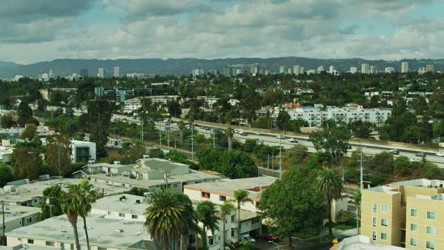 drone flight over culver city apartment buildings towards santa monica freeway - interstate 10 stock videos & royalty-free footage
