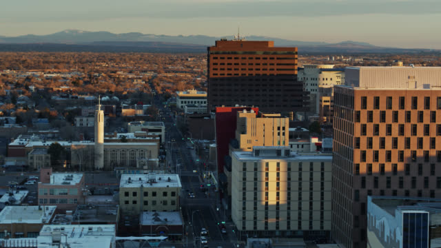 drone flight over downtown streets in albuquerque at dawn - albuquerque new mexico stock videos & royalty-free footage