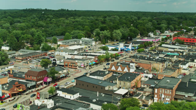 drone flight over downtown wisconsin dells - high street stock videos & royalty-free footage