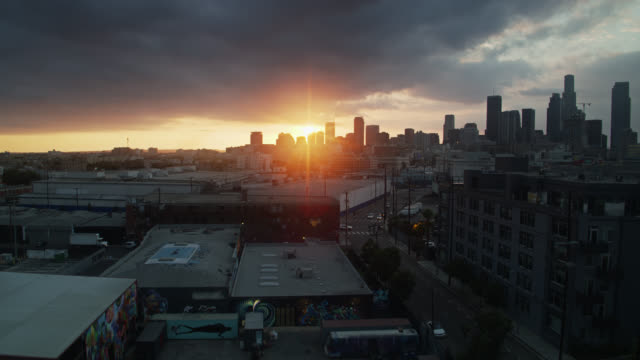 drone flight over dtla arts district at sunset - los angeles county stock-videos und b-roll-filmmaterial
